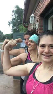 Mom and daughters flexing